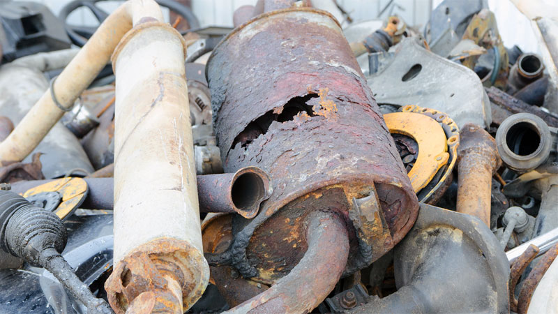 old muffler with hole in it