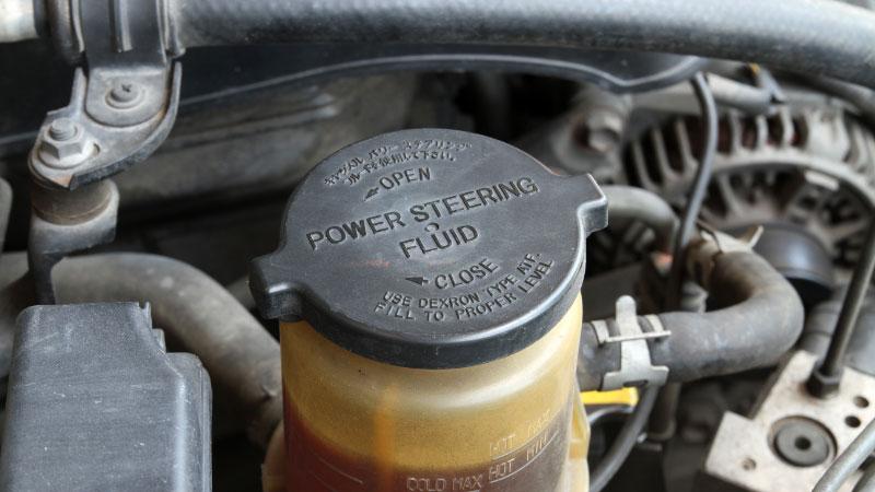 clogged power steering fluid reservoir